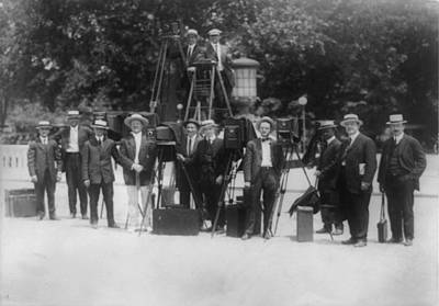 News Photographers Posing With Cameras Art Print by Everett