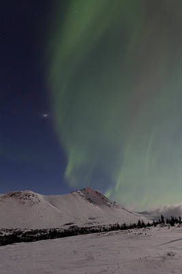 Northern Lights Over A Mountain Art Print by Tim Grams