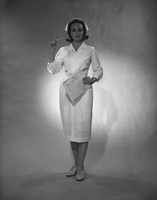 Nurse Holding Medical Chart Posing In Studio, (b&w), Portrait Art Print by George Marks