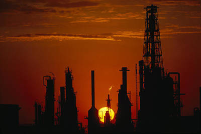 Oil Refinery Silhouetted Art Print by Paul Chesley