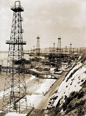 Oil Well Derricks On The Beach Art Print by Everett