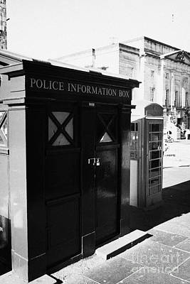 Royal Mile Photograph - Old Blue Police Information Box And Red Telephone Box On Lawnmarket On The Royal Mile Edinburgh Scot by Joe Fox