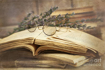 Old Books Open On Wooden Table  Print by Sandra Cunningham