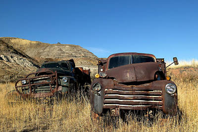Mining Truck Photograph - Old Coal Mining Trucks Rust In A Field by Pete Ryan