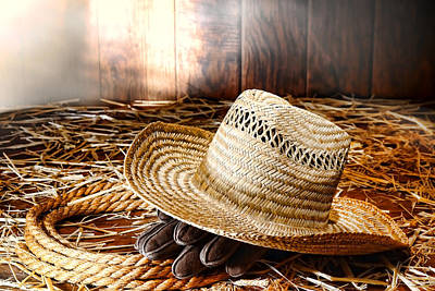 Old Farmer Hat In Hay Barn Art Print by Olivier Le Queinec