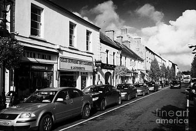 Ballina Photograph - Old Shops On Pearse Street Central Ballina Town County Mayo Republic Of Ireland by Joe Fox