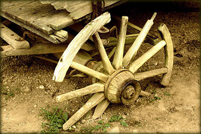 Photograph - Old Wagon Wheel by Susie Weaver