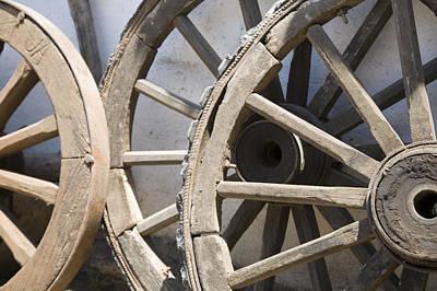Wagon Wheel Hub Wall Art - Photograph - Old Wooden Wagon Wheels Leab by David Evans