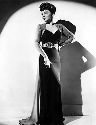 Evening Gown Photograph - Olivia De Havilland In A Black Crepe by Everett