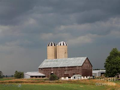 Ominous Clouds Over The Barn Art Print by J McCombie