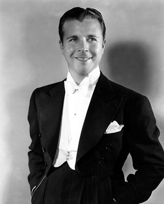 1937 Movies Photograph - On The Avenue, Dick Powell, 1937 by Everett