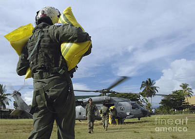 Photograph - Operator Loads Rice Into An Hh-60h by Stocktrek Images