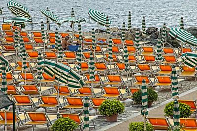Orange Beach Chairs  Art Print by Mauro Celotti