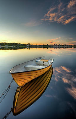 Orange Boat With Strong Reflection Art Print
