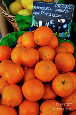 Oranges Displayed In A Grocery Shop Print by Sami Sarkis
