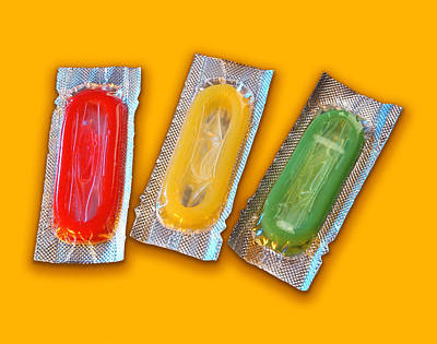 Different Colours Photograph - Packets Of Condoms by Mark Sykes