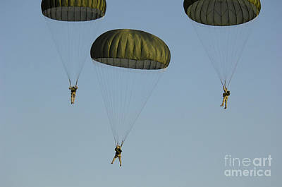 Rowing Royalty Free Images - Paratroopers Descend Through The Sky Royalty-Free Image by Stocktrek Images