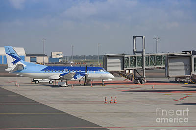 Tallinn Airport Photograph - Parked Airplane At An Airport Gate by Jaak Nilson