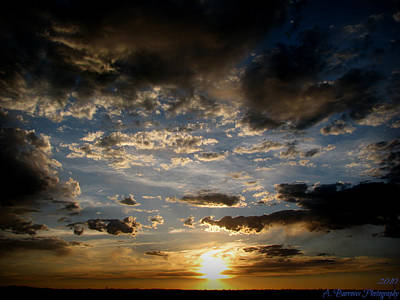 Partly Cloudy Skies At Sunset Art Print by Aaron Burrows