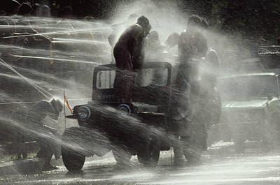 People Are Sprayed At The Water Art Print by James L. Stanfield