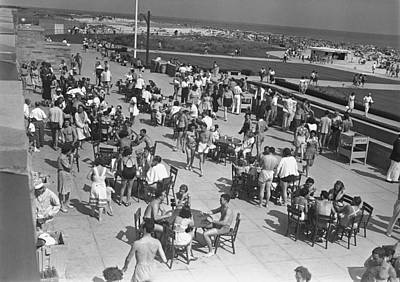People Sitting At Tables By Beach, (b&w), Elevated View Art Print by George Marks