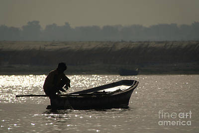 Cremation Ghat Photograph - Perched On A Boat by Serena Bowles