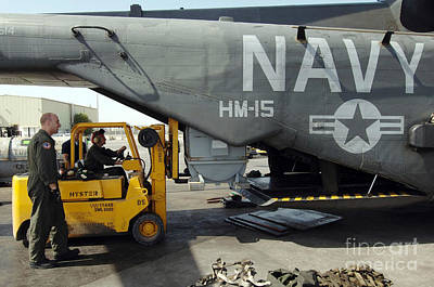 Personnel Load Cargo Onto A Mh-53e Sea Art Print by Stocktrek Images
