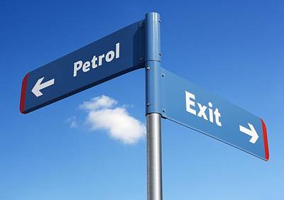 Petrol And Exit Signs Print by Mark Sykes