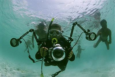 Photographer With Camera Underwater Art Print by Nicolas Reynard