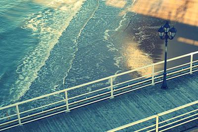 Pier With Lamp On Coast Of North Sea Art Print by Photo by Ira Heuvelman-Dobrolyubova
