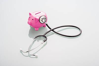 Piggy Bank Gets A Health Check-up Art Print by Nicholas Rigg