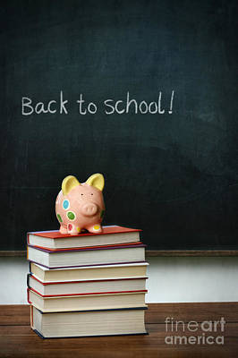 Photograph - Piggybank And Books In Front Of Chalkboard by Sandra Cunningham