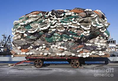 Pile Of Commercial Fishing Nets Art Print by Paul Edmondson