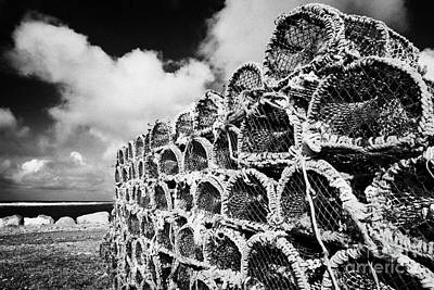 Pile Of Lobster Pots Stacked In The West Coast Of Ireland Art Print by Joe Fox