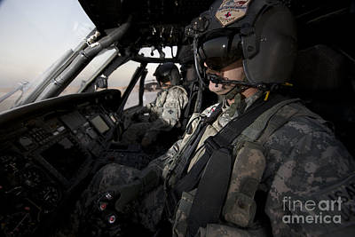 Pilot In The Cockpit Of A Uh-60l Art Print by Terry Moore