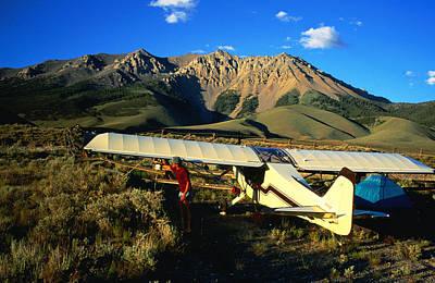 Pilot Of Ultralight Plane Taking Camping Excursion, Near Borah Peak, Idaho, United States Of America, North America Art Print by Holger Leue