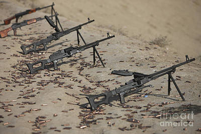 Pk Machine Guns And Spent Cartridges Art Print by Terry Moore