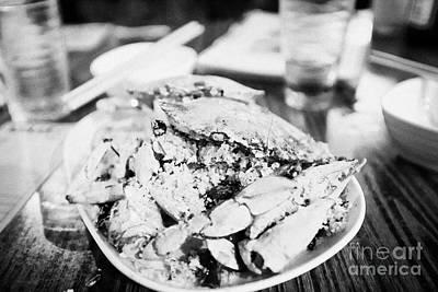 Tsui Photograph - Plate Of Spicy Crab Seafood At A Table In An Outdoor Cafe At Night Kowloon Hong Kong Hksar China by Joe Fox