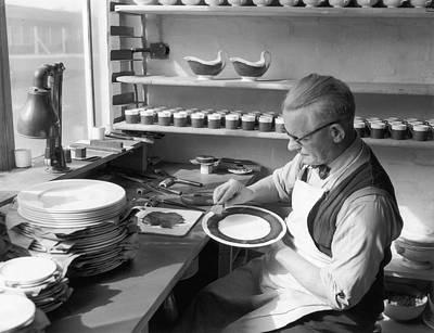 Plate Painter Art Print by L Blandford