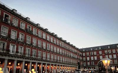Photograph - Plaza Mayor And Lamp Posts At Sundown With Lights In Madrid Spain by John Shiron
