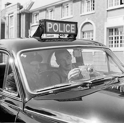 Police Camera Action Art Print by Ken Harding