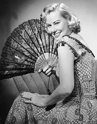Portrait Of Blonde Woman Holding Fan Art Print by George Marks