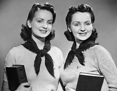 Portrait Of Teenaged Twin Girls Holding Books Art Print by George Marks