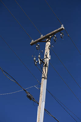 Power Lines Against A Clear Sky Art Print by John Burcham