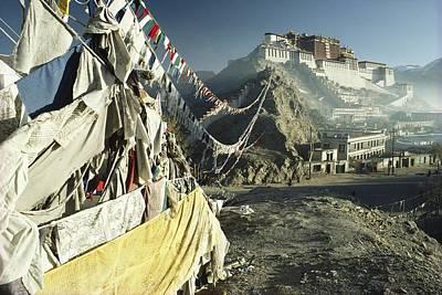 The Dalai Lama Photograph - Prayer Flags Wave Outside The Potala by Gordon Wiltsie