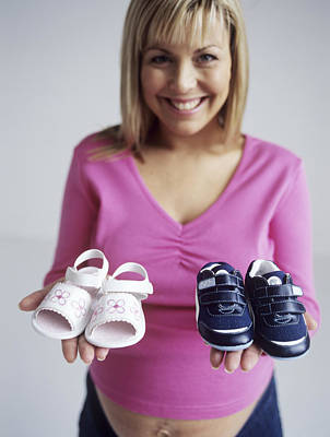 Pregnant Woman With Baby Shoes Print by Ian Boddy