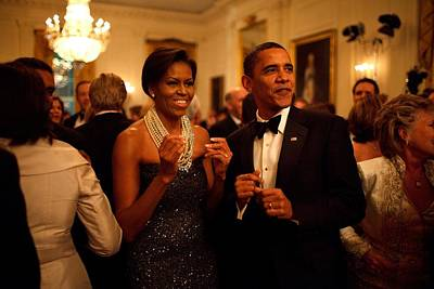 Barack Obama Photograph - President And Michelle Obama Applaud by Everett