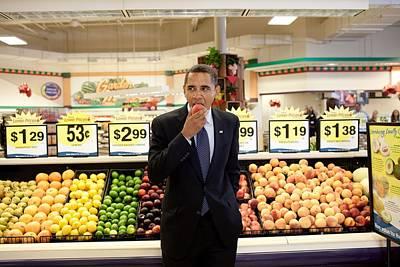 President Barack Obama Eats A Peach Art Print by Everett