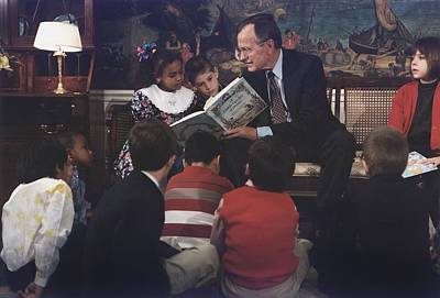 President George H. W. Bush Reads A Art Print by Everett