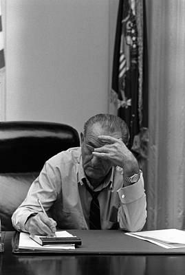 President Lyndon Johnson Making Notes Print by Everett